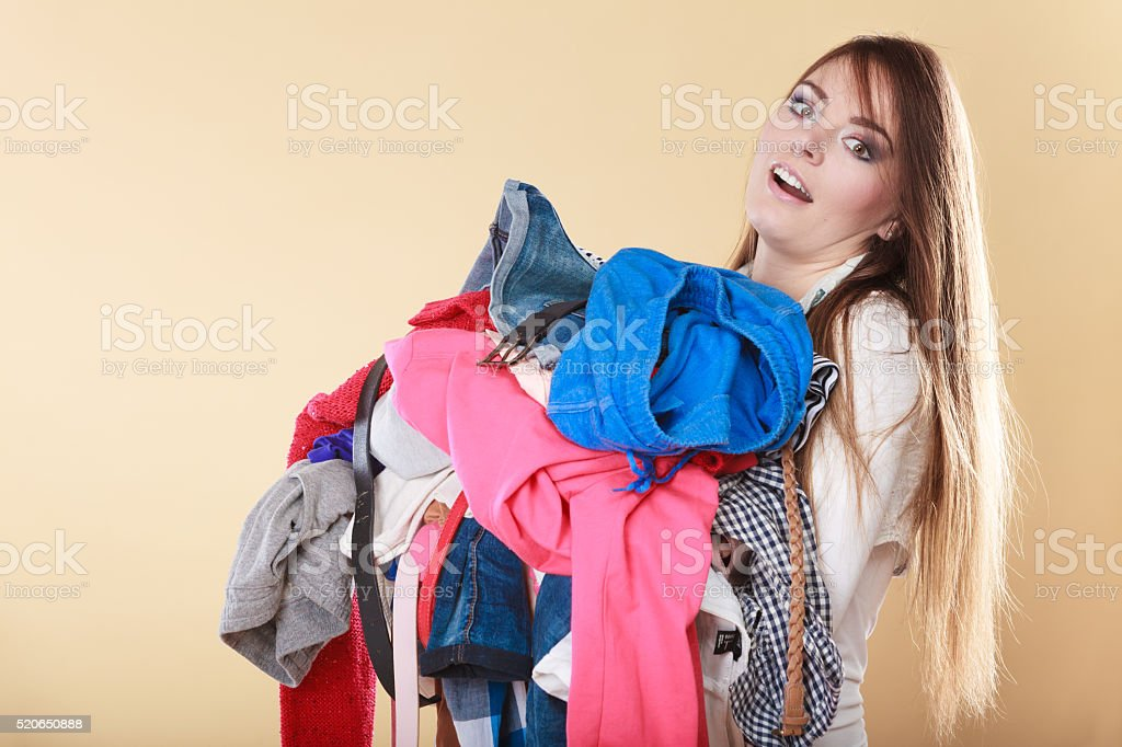 Woman carrying dirty laundry clothes. stock photo