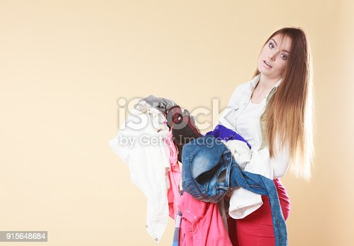 460589747istockphoto Woman carrying dirty laundry clothes. 915648684