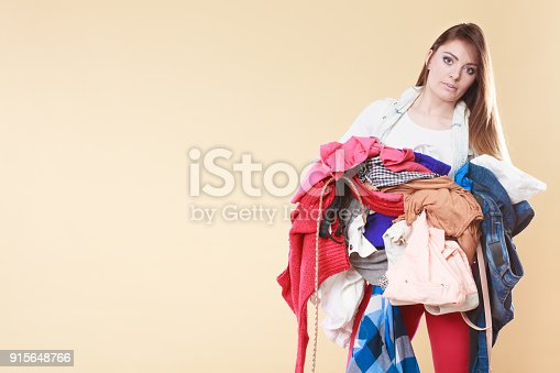 460589747istockphoto Woman carrying dirty laundry clothes. 915648766