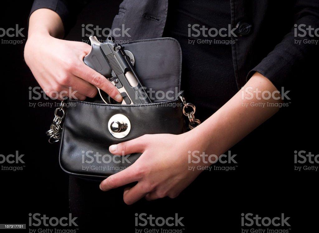 Woman Carrying Handgun stock photo
