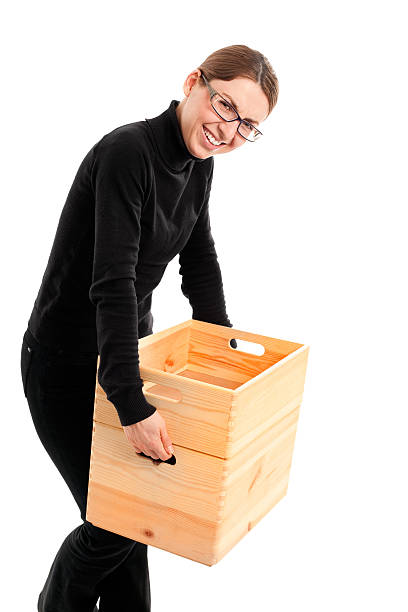 Woman Carrying Heavy Case stock photo