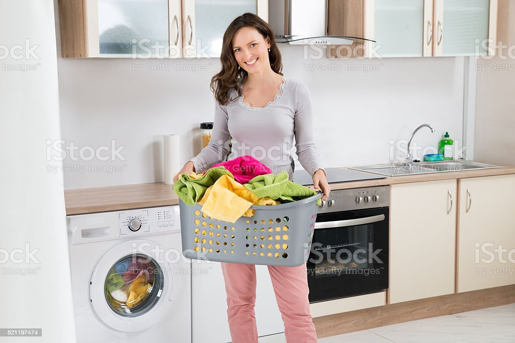 Woman Carrying Laundry Basket stock photo