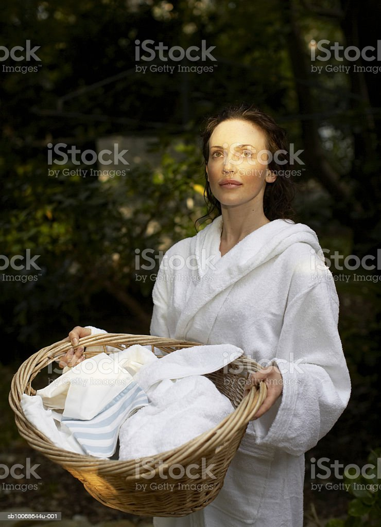 Woman carrying laundry basket royalty-free stock photo