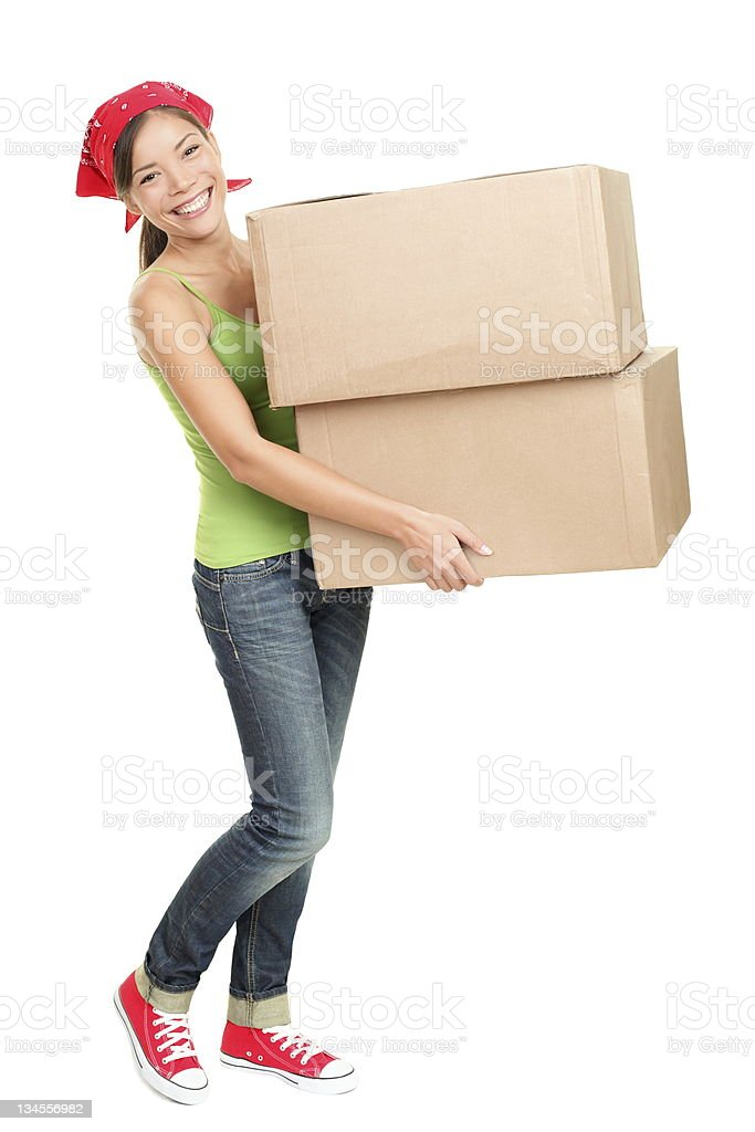 Woman carrying moving boxes stock photo