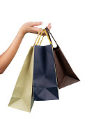 istock Woman carrying paper shopping bags isolated on white background. Adult woman hand hold three shopping bag with blue and brown color. Customer and shopping bag. Black Friday concept. Consumerism. 1131702020