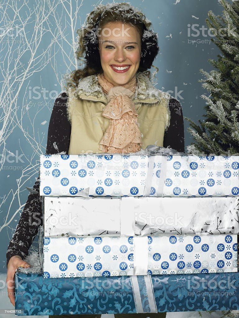 Woman carrying presents royalty-free stock photo