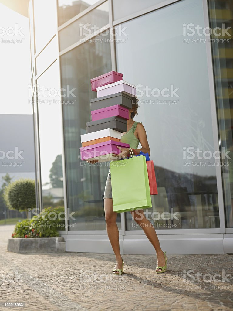 woman carrying shoe boxes stock photo