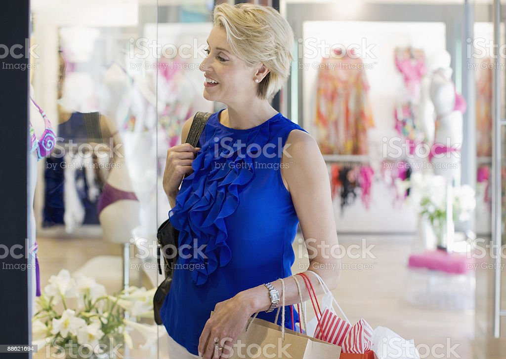 Woman carrying shopping bags in mall royalty-free stock photo