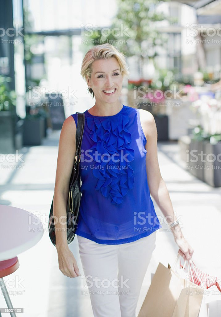Woman carrying shopping bags royalty-free stock photo