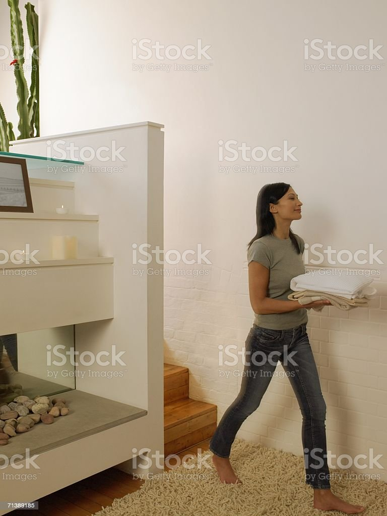 Woman carrying towels royalty-free stock photo