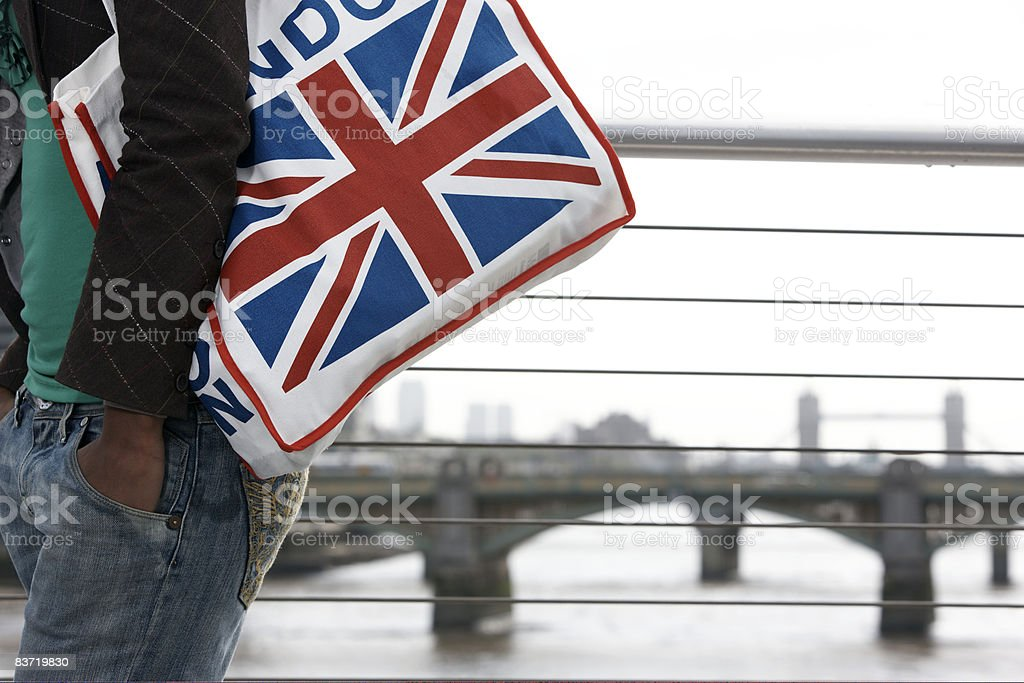 Woman carrying Union Jack bag royalty-free stock photo