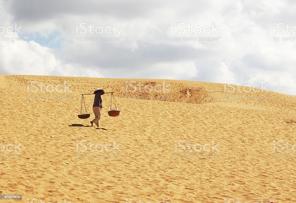 woman carrying water royalty-free stock photo