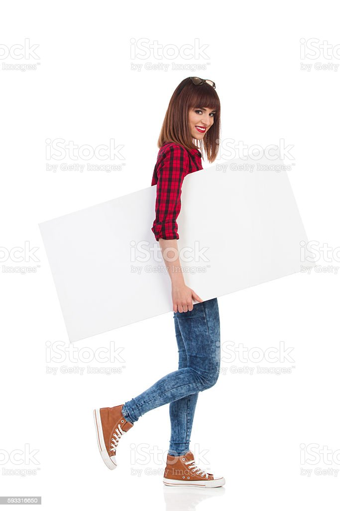 Woman Carrying White Placard Under The Arm stock photo