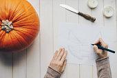 Woman holding a Halloween pumpkin