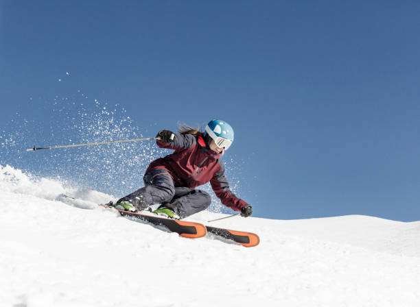 woman carving skiing - aluxum stock pictures, royalty-free photos & images