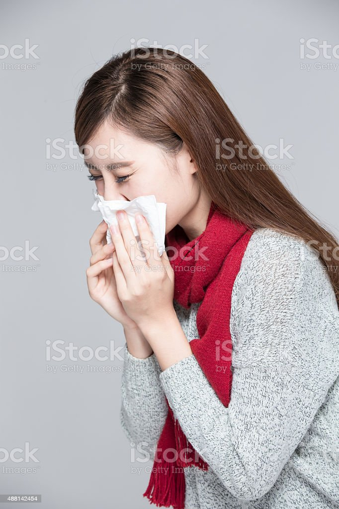 woman catches a cold feel bad stock photo