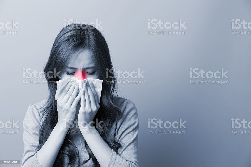 Woman catches a cold stock photo