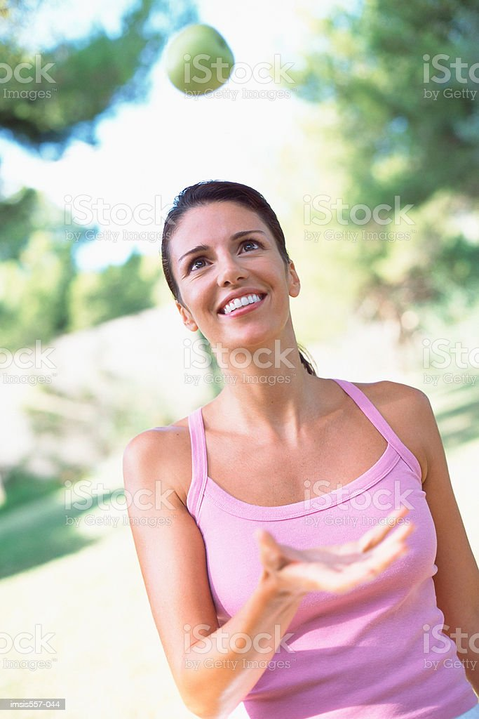 Woman catching apple royalty-free stock photo