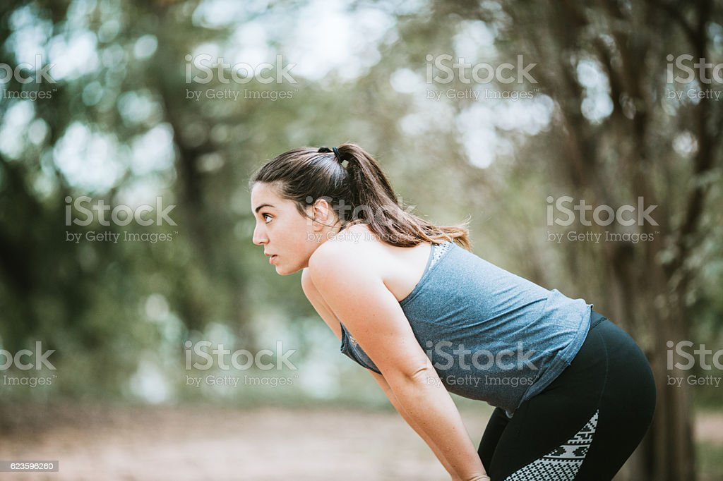 Woman Catching Breath After Exercise stock photo