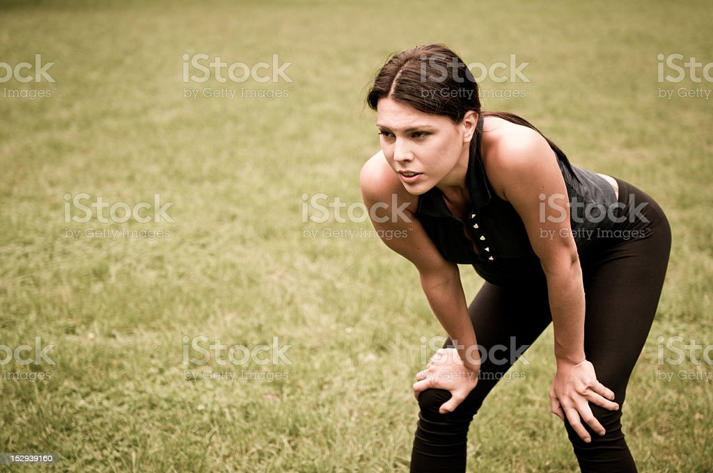 Woman catching her breath after jogging royalty-free stock photo