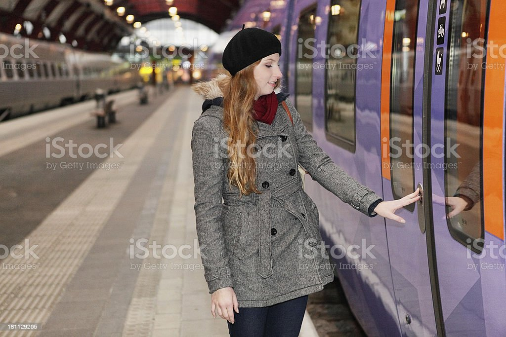 Woman catching train royalty-free stock photo