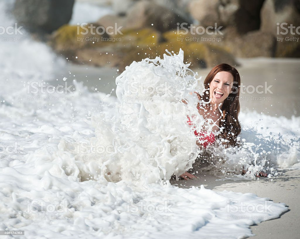 Woman caught by a Wave royalty-free stock photo