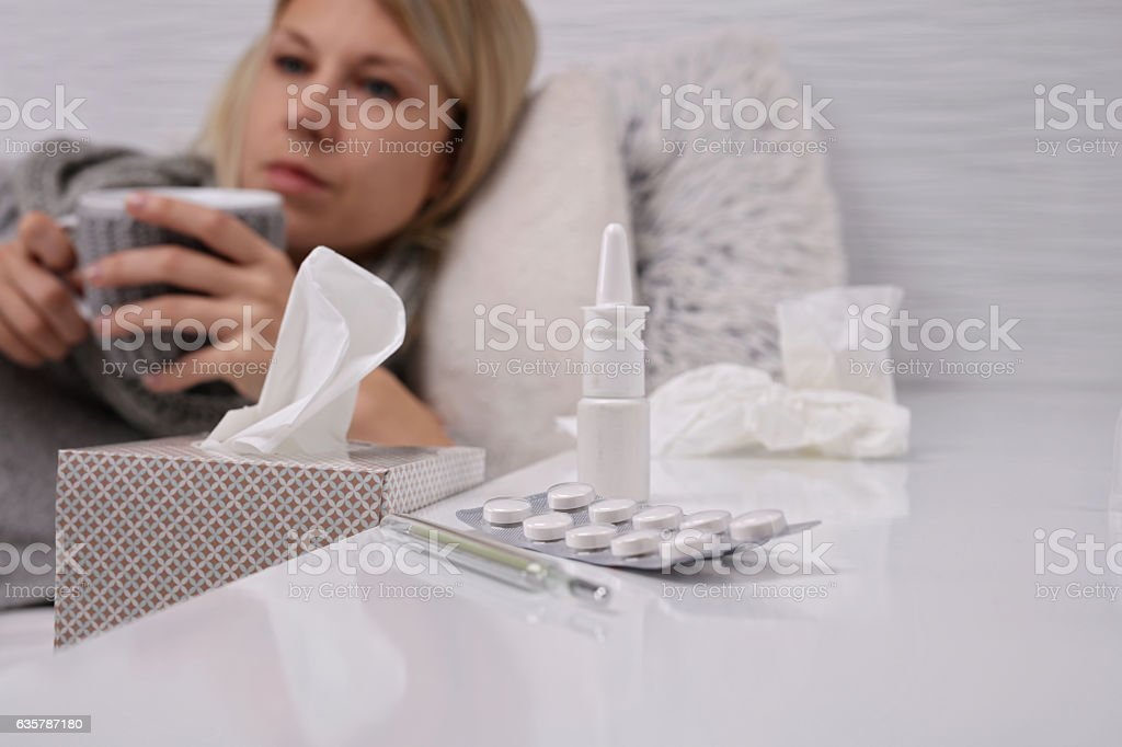 Woman caught cold and drinking hot tea. Flu, headache stock photo