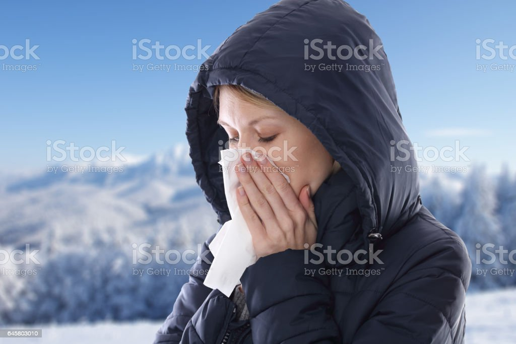 Woman caught cold , flu, running nose. Healthcare and medical concept stock photo