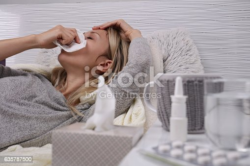 istock Woman caught cold , flu, running nose. 635787500