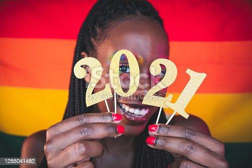 istock Woman celebrating 2021 - Happy New Year! 1255041482