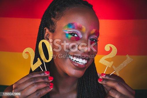 istock Woman celebrating 2021 - Happy New Year! 1255042999