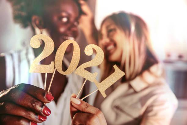 Woman celebrating 2021 New Year stock photo