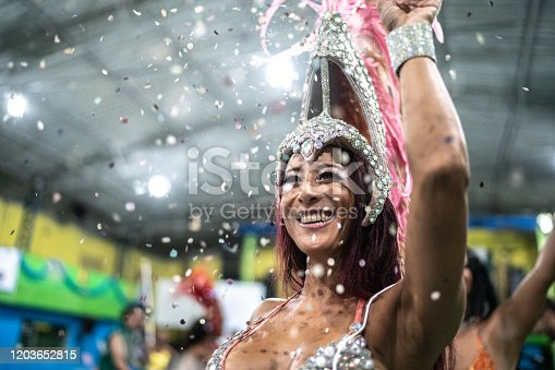 1016084100istockphoto Woman (passista) celebrating and dancing carnival at school carnival 1203652815