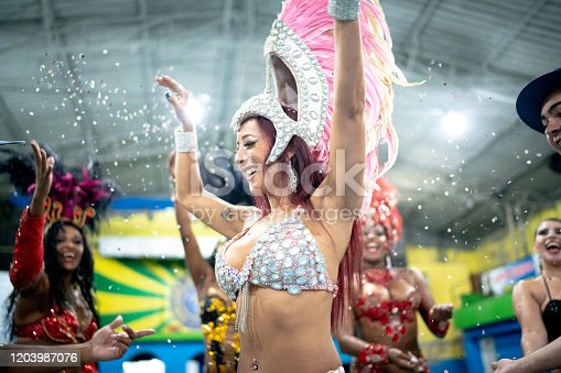 1016084100istockphoto Woman (passista) celebrating and dancing carnival at school carnival 1203987076