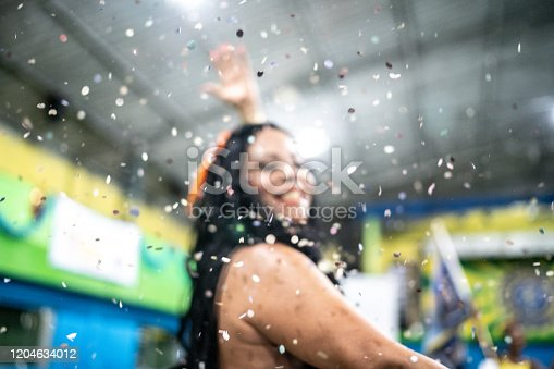 1016084100istockphoto Woman (passista) celebrating and dancing carnival at school carnival 1204634012