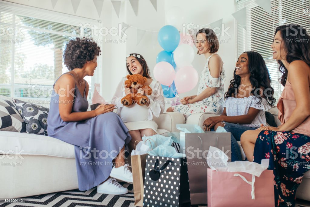 Woman celebrating baby shower with friends - foto stock