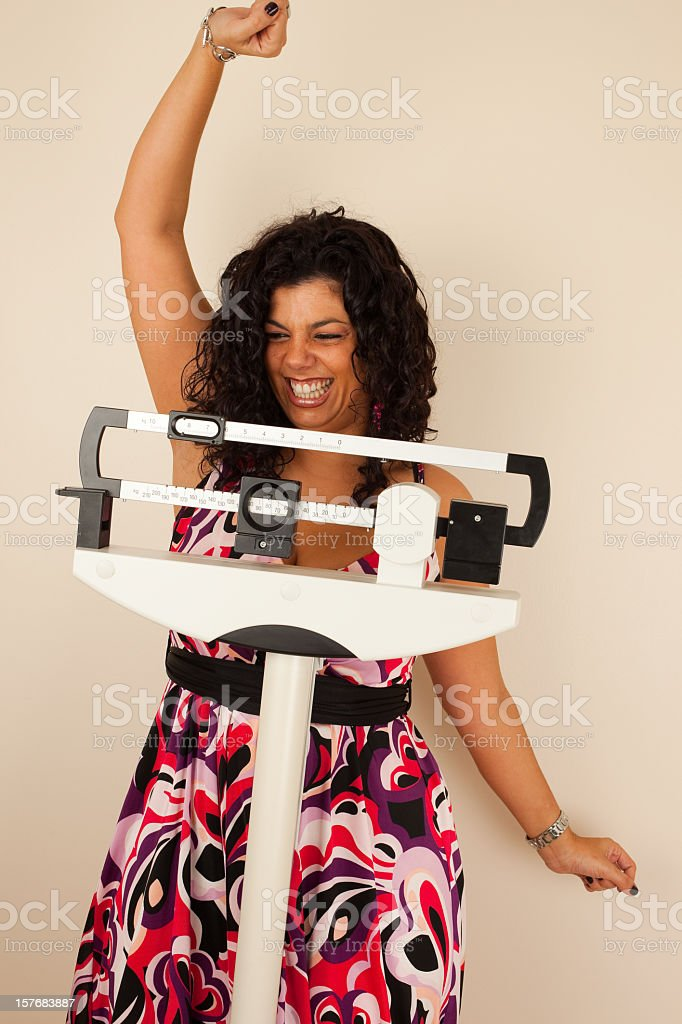 Woman celebrating her extreme weight loss royalty-free stock photo
