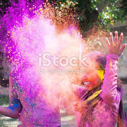 Woman celebrating the festival of Holi in Jaipur, India.