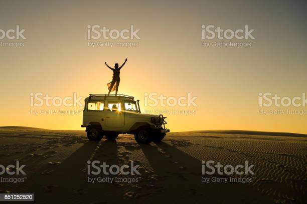 Woman celebrating on top of offroad car picture id851252520?b=1&k=6&m=851252520&s=612x612&h=kb8af9ytnoxo8jnswucogfy3dngynq3pfaiaw5goydu=