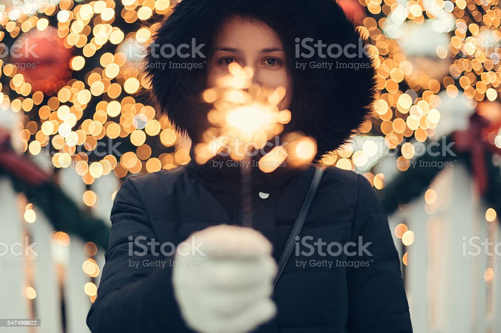 Woman celebrating with bengal fire stock photo