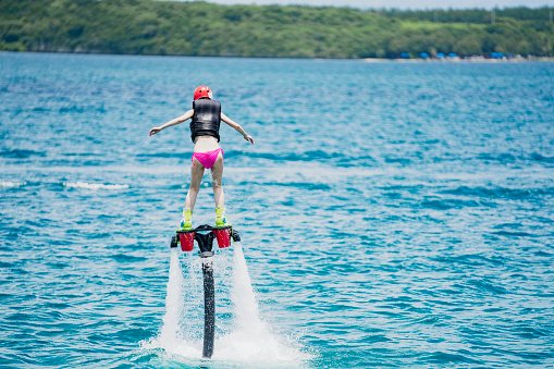 istock Woman challenging flyboard in guam 838090322
