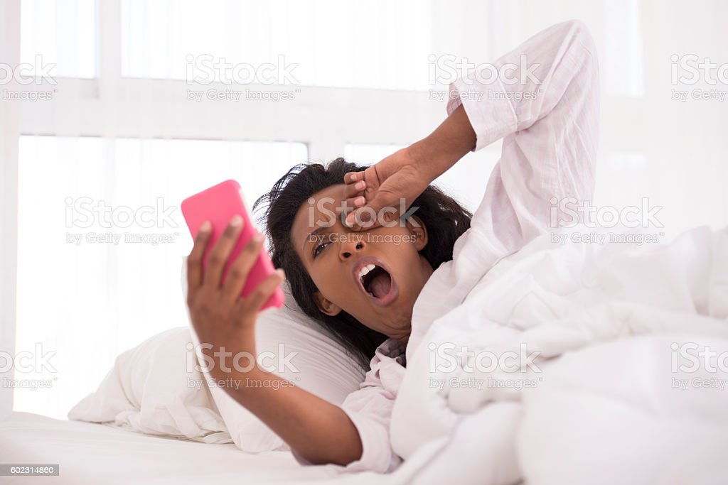 Woman chatting on smartphone yearly morning. stock photo