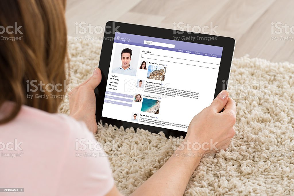 Woman Chatting On Social Website stock photo