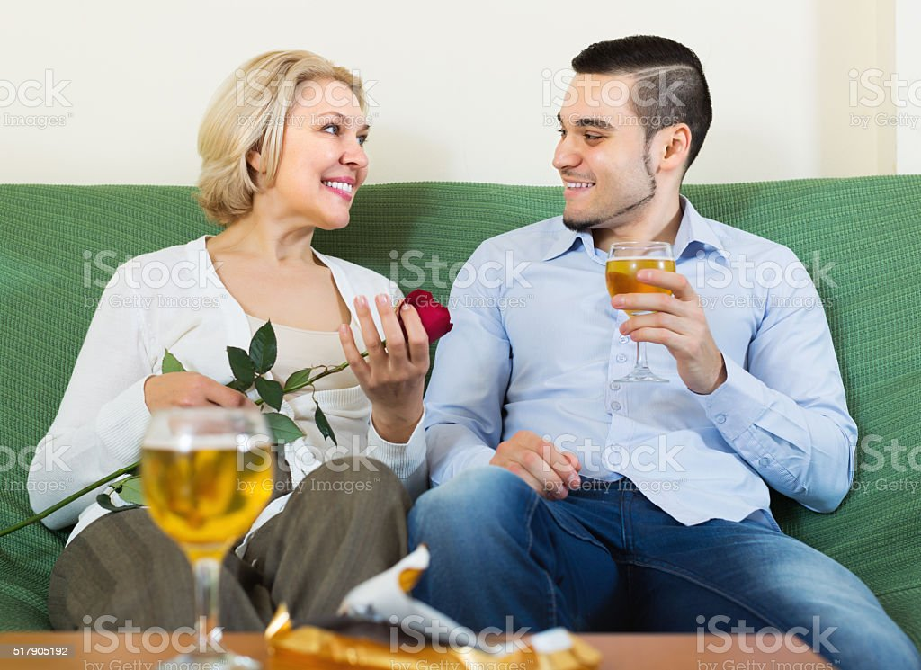 Woman chatting with young boyfriend stock photo