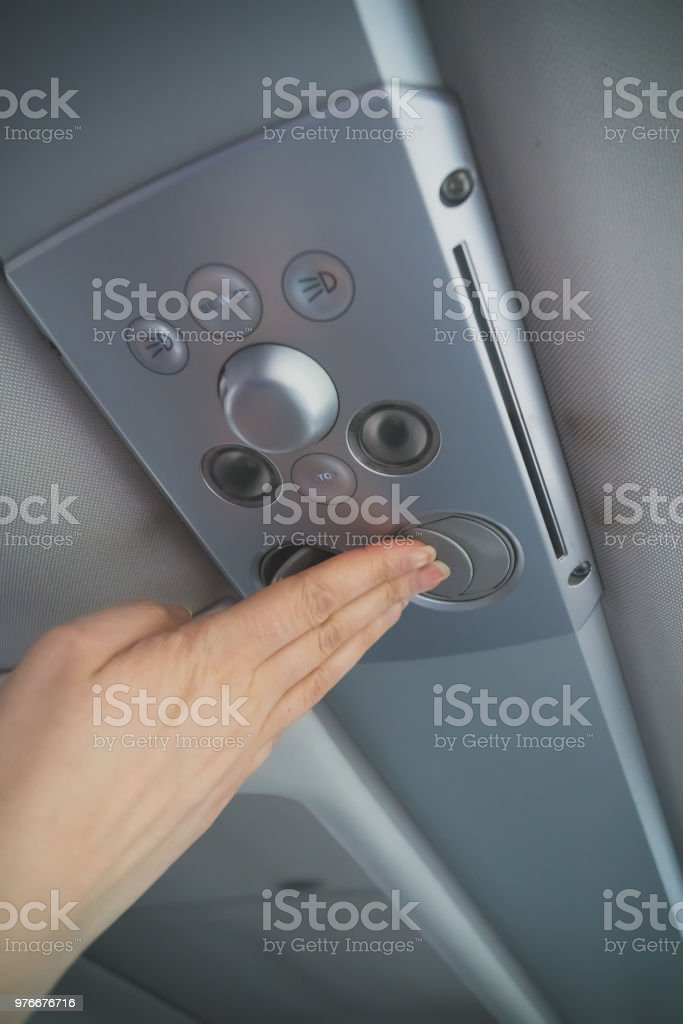 Woman checking air-conditioning system in bus. stock photo
