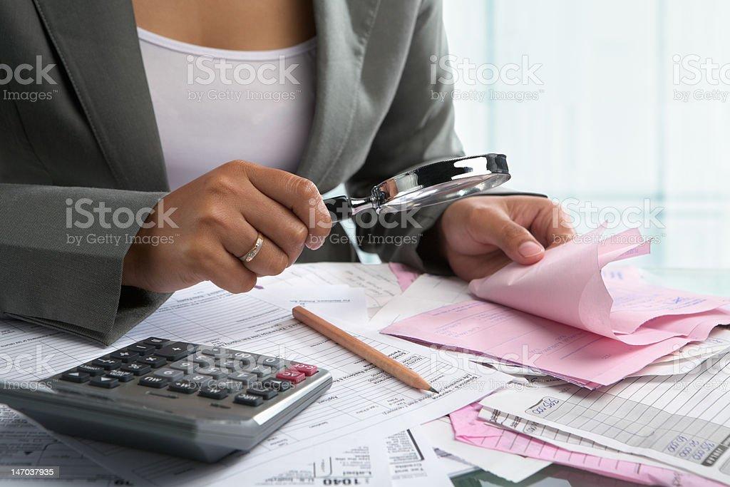 Woman checking bills royalty-free stock photo