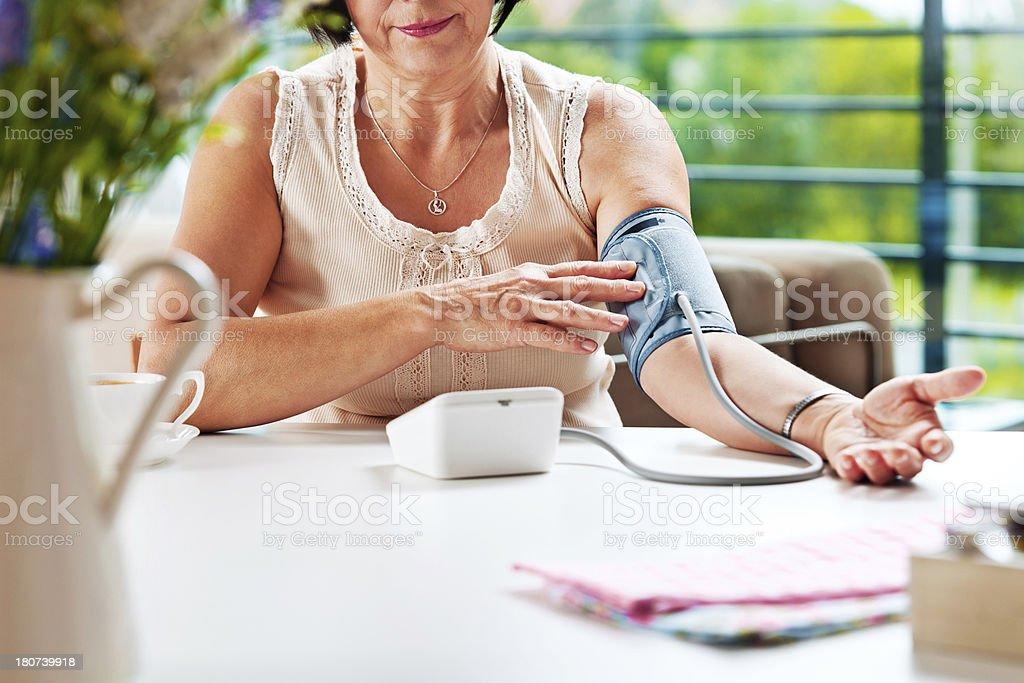 Woman checking blood presure stock photo
