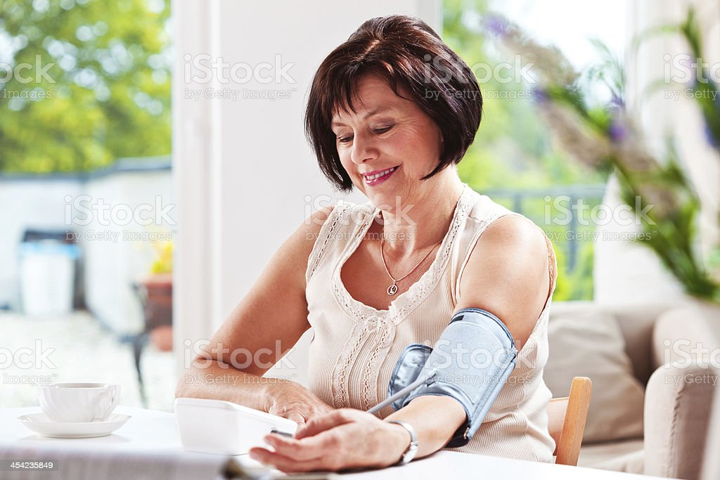 Woman checking blood presure stock photo