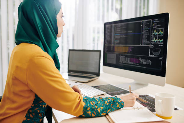 Woman checking code implementation stock photo