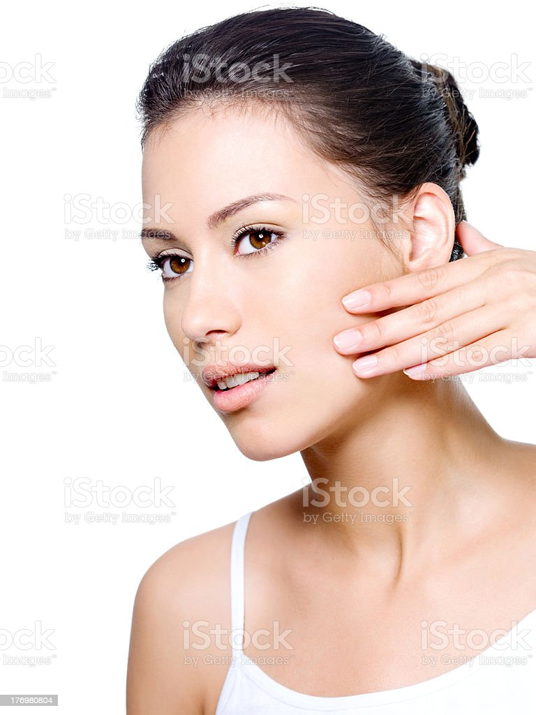 Woman checking creases on her face stock photo